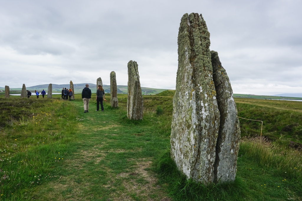 On a green hill is a circle of large standing stones