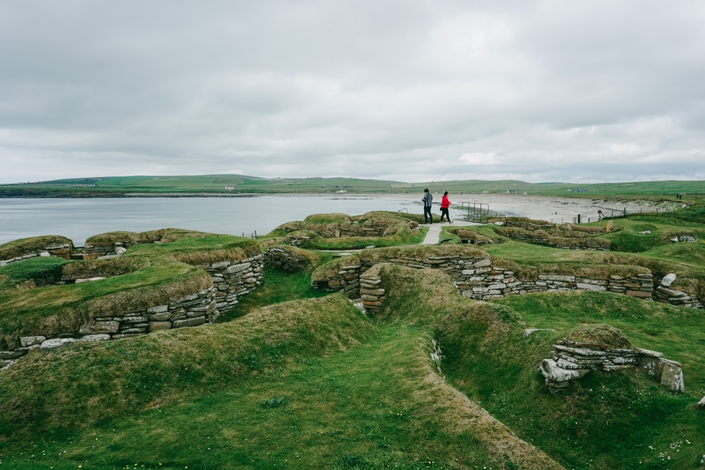 Neolithic village ruins with stones built in circles that would have once been rooms that people lived in