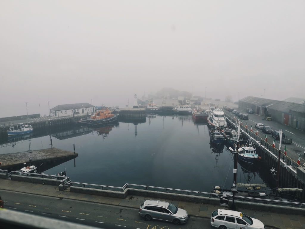 The harbour at Kirkwall with boats amongst the morning mist